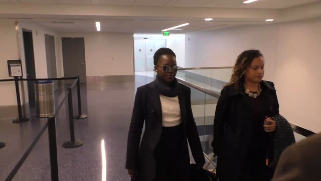 lupita nyong'o departing at lax airport in los angeles in celebrity sightings in los angeles - lupita nyong'o stock videos and b-roll footage