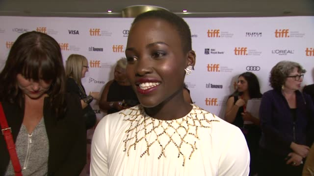 INTERVIEW Lupita Nyong'o on the event at '12 Years A Slave' Premiere 2013 Toronto International Film Festival on 9/6/2013 in Toronto Canada