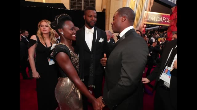 Lupita Nyong'o Winston Duke and Marcus Henderson attend the 90th Annual Academy Awards at Hollywood Highland Center on March 4 2018 in Hollywood...