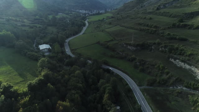 vídeos de stock e filmes b-roll de lush country road in spain, aerial - folhagem viçosa