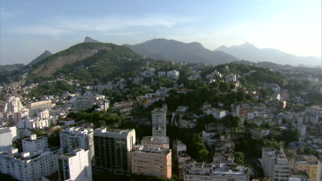 lush trees surround mansions and a castle on a hill in rio de janeiro. - capital cities stock videos & royalty-free footage