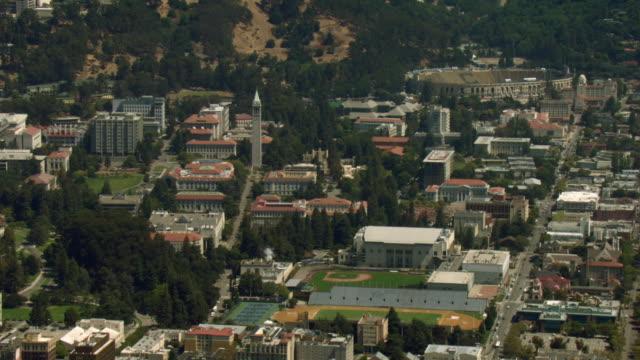 lush trees surround the buildings on the campus of the university of california, berkeley. - university of california bildbanksvideor och videomaterial från bakom kulisserna