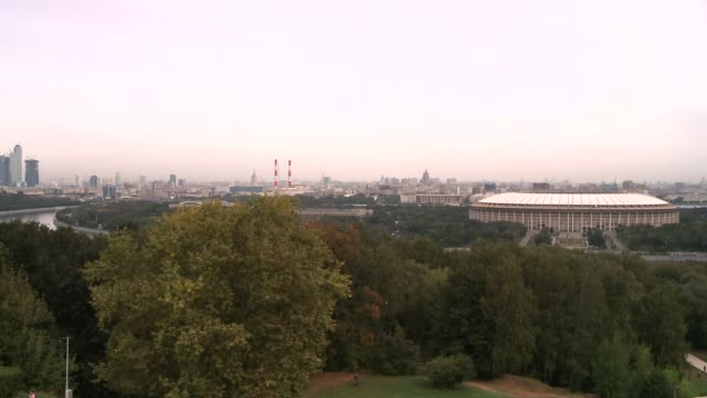 Lush trees surround the Luzhniki Stadium in Moscow. Available in HD.