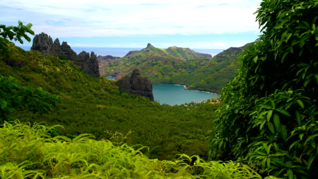 lush vegetation ocean bay volcanic mountains nuku hiva - polynesian ethnicity stock videos & royalty-free footage