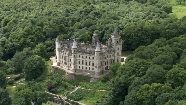 Lush woodlands surround a beautiful castle in Scotland. Available in HD.