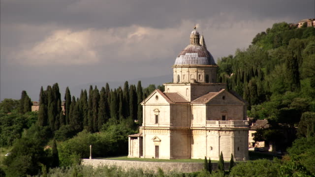 Lush woodlands surround the San Biagio church, Montepulciano. Available in HD.