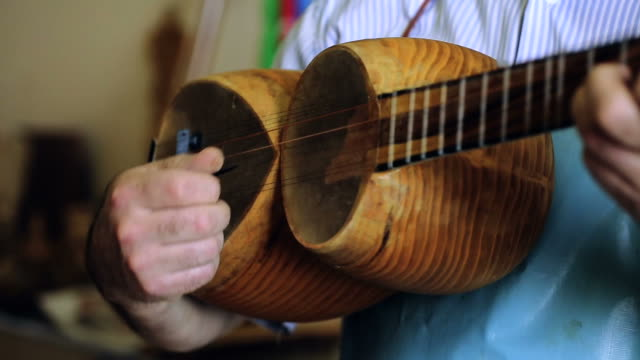 luthier maker workshop and classical music instruments making musical instruments - tar - azerbaigian video stock e b–roll