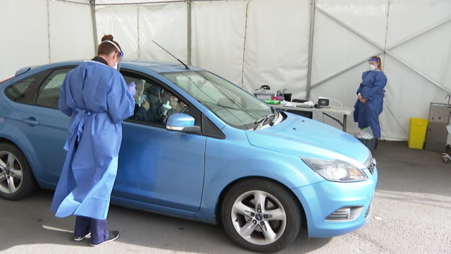 luton and dunstable hospital carrying out routine lung function tests to patients in their cars rather than in the hospital to help clear backlog... - touching stock videos & royalty-free footage