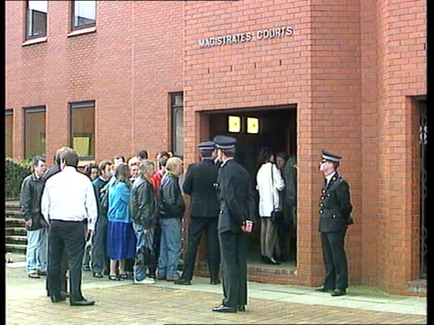 court appearance; england beds luton magistrates court gv front of court with two groups of people standing apart - relatives of accused john... - lunge stock videos & royalty-free footage