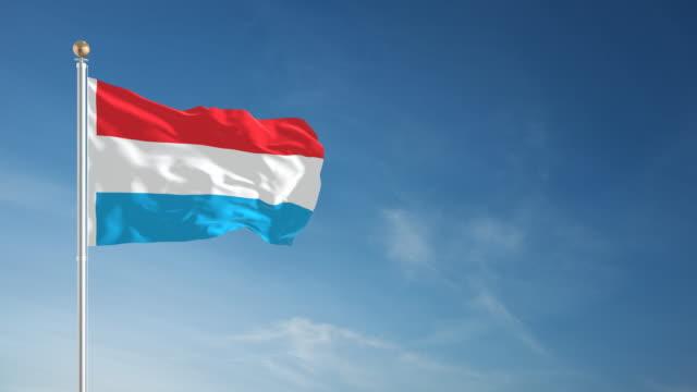 stockvideo's en b-roll-footage met 4k luxemburg vlag - loopbare - paalzitten
