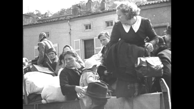 "luxembourg refugees walk toward camera with belongings, two trucks behind them / truck passes with people and belonging in back, ""brasserie"" written... - world war ii stock videos & royalty-free footage"