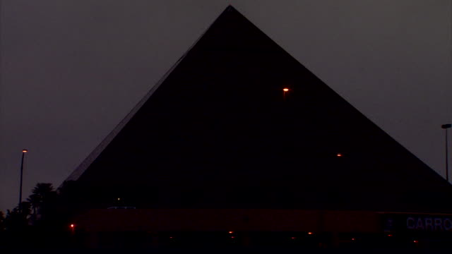 Luxor Hotel pyramid w/ traffic moving through frame FG Las Vegas Boulevard The Strip south