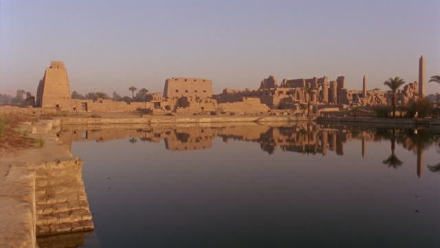 ws pan luxor temple with large pond/ luxor, egypt - luxor thebes stock videos and b-roll footage