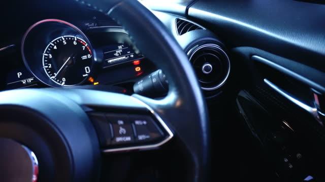 vídeos y material grabado en eventos de stock de lujoso interior del coche - coche híbrido