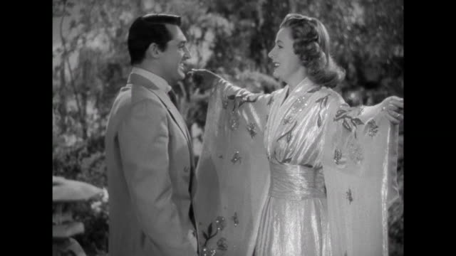 1941 Luxurious gifts for wife (Irene Dunne) as husband (Cary Grant) announces new higher paying job