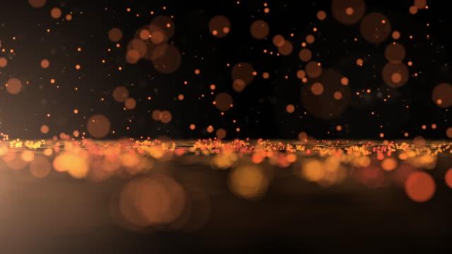 Luxuriöse gold glitzernden Partikel Bounce Hintergrund