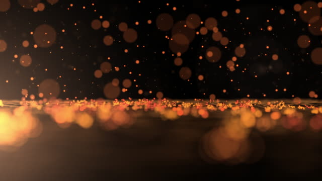 luxurious gold sparkling particles bounce background - anniversary stock videos & royalty-free footage