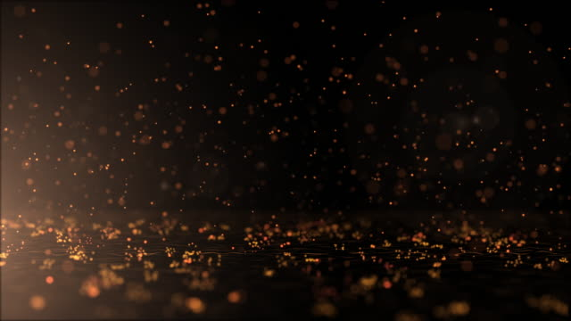 Luxurious gold sparkling particles Bounce background