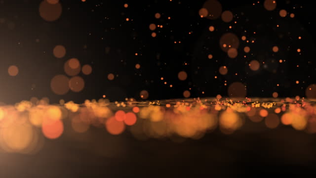 luxurious gold sparkling particles bounce background - stage performance space stock videos and b-roll footage