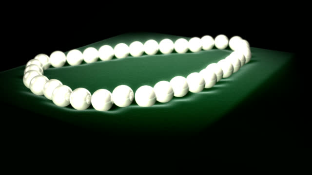 stockvideo's en b-roll-footage met luxurious pearls on emerald green velvet 3d (loopable) - parel juwelen