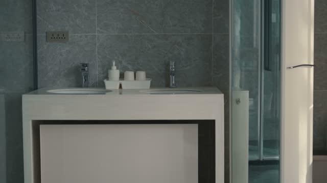 luxury apartment bathroom panning shot - bathroom sink stock videos & royalty-free footage