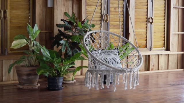luxury bespoke indoor boho hanging chair - boho stock videos & royalty-free footage