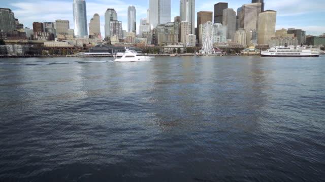 luxury boat cruising through city harbor - seattle video stock e b–roll