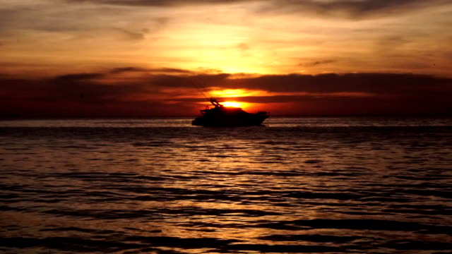 luxury boat on calm sea silhouette at sunset - ko lanta stock videos & royalty-free footage