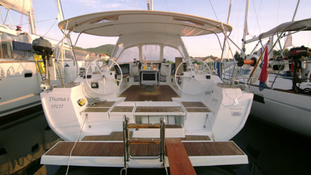 ws luxury boat tied up on a pier - stationary stock videos & royalty-free footage
