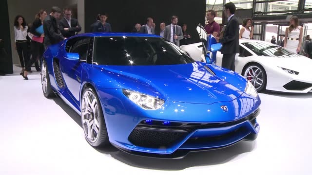 vídeos de stock, filmes e b-roll de luxury brand lamborghini presents its first hybrid car at the paris car show the asterion fuelled by battery in the city and reaching 320 kilometres... - veículo com combustível alternativo