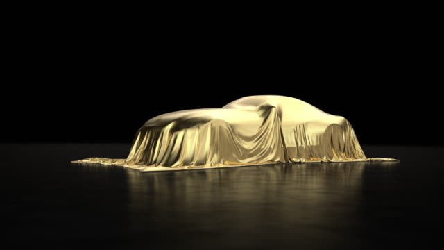 luxury car a covered with a gold cloth - showroom stock videos & royalty-free footage