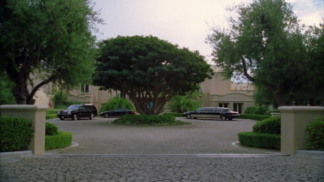 ws luxury cars parking in front of mansion - hummer stock videos and b-roll footage