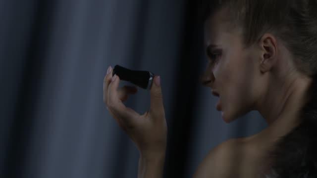 luxury fashion model in silver fox fur handles black nail polish bottle, hissing on it. fashion video. - eyelash stock videos & royalty-free footage