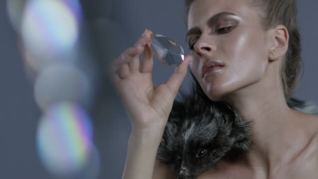 luxury fashion model wearing fur holds a diamond. fashion video. - femininity stock videos and b-roll footage