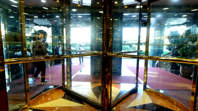 luxury glass modern door automatic rotating at hotel - exit sign stock videos & royalty-free footage