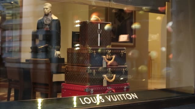 luxury handbags sit in the window display of an lvmh moet hennessy louis vuitton se boutique at the gum department store on red square in moscow... - purse stock videos & royalty-free footage