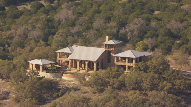 MS AERIAL TS luxury home in Hill Country in route from Lyndon Baines Johnson Ranch to Luckenbach / Texas, United States