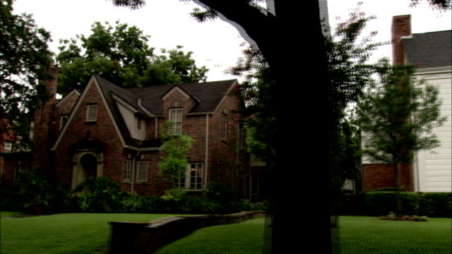 Luxury homes fill a neighborhood in Houston. Available in HD.
