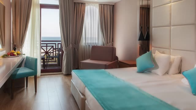 luxury hotel bedroom interior - modern bedroom stock videos & royalty-free footage