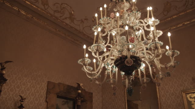 ms td. luxury hotel bedroom with chandelier and four poster bed / bologna, italy - palace stock videos & royalty-free footage