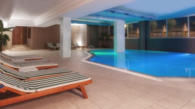 vidéos et rushes de luxury hotel resort piscine couverte - établissement de cure