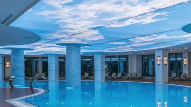 luxury hotel resort indoor swimming pool - panoramic stock videos & royalty-free footage