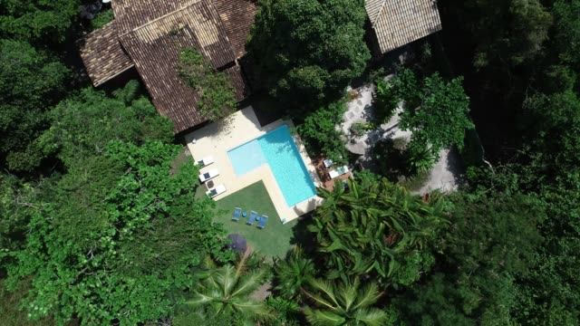 luxury hotel swimming pool rotating drone aerial point of view moving up from - moving up stock videos & royalty-free footage