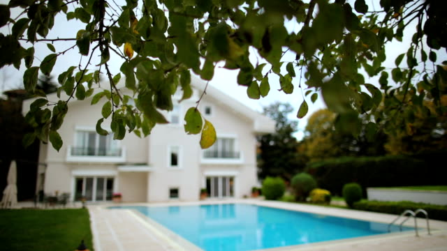 luxury house with swimming pool - real estate background - dolly shot stock videos & royalty-free footage