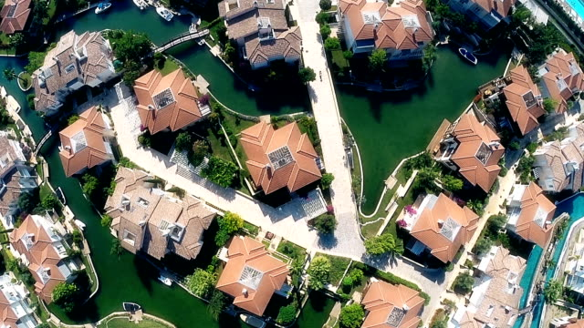 luxury houses by the sea with artificial canals for boats - surveillance stock videos and b-roll footage