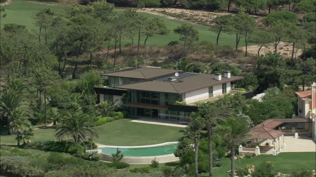 aerial ws luxury houses in parque natural de sintra-cascais / cascais, lisbon, portugal - cascais stock videos and b-roll footage