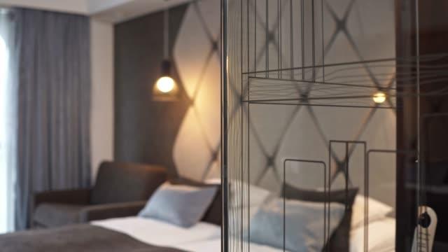 luxury inside a modern hotel room - tidy room stock videos & royalty-free footage
