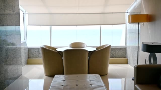luxury interior of living room with sea view - holiday villa stock videos & royalty-free footage