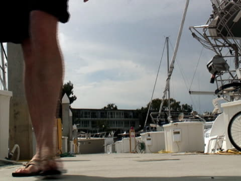 luxury lifestyle: man on boat dock - coming - flip flop stock videos and b-roll footage