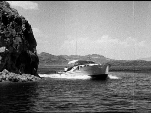 luxury motorboat pulling two water skiers ws female male water skiing summer recreation fun leisure nevada arizona reservoir national recreation area - lake mead video stock e b–roll